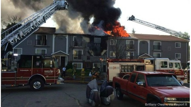 Mom tosses baby from balcony to escape Michigan apartment fire