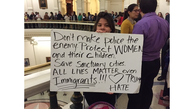 Protester says _save sanctuary cities. All lives matter even immigrants.__408338