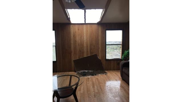 Strong winds blew the roof into this Elgin home_422490