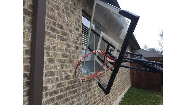 Basketball equipment sent flying through window by strong overnight winds_422634
