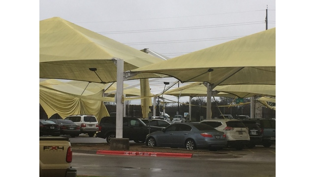 Roof of parking lot at the Austin airport damaged in overnight storms_422489