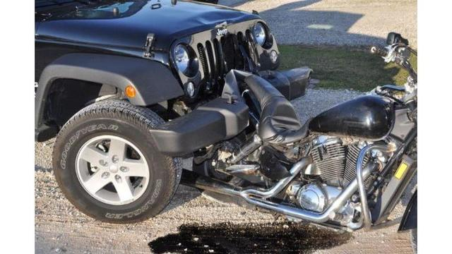 DUI suspect drives home with victim's motorcycle lodged in front bumper