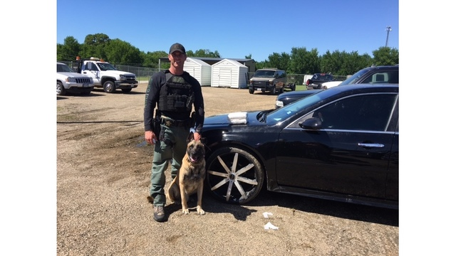 Lobos and Sgt. Randy Thumann with cocaine (Fayette County Sheriff's Office photo)_448150