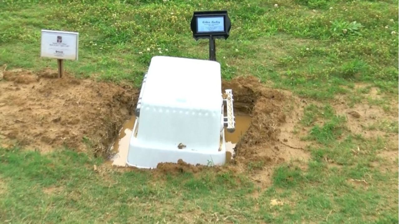 baby s casket found floating upside down in water filled grave