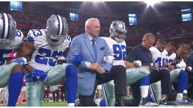 Trump reacts as Cowboys kneel, then rise, before national anthem starts