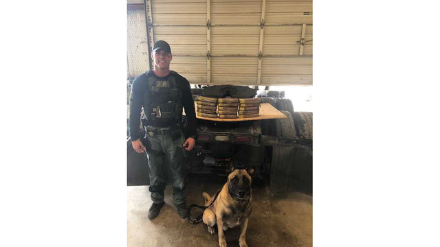 Sgt. Randy Thumann and K-9 Lobos with the cocaine found in an 18-wheeler on May 22, 2018